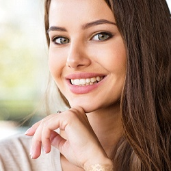 Woman with an attractive smile after cosmetic bonding.