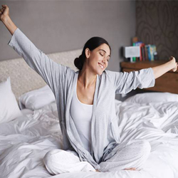 Woman waking up and stretching