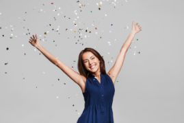 Confetti dropping on a smiling woman