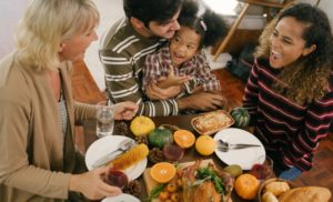 family of four enjoying a Thanksgiving meal