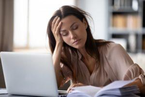 woman who needs sleep apnea treatment in Calimesa falling asleep at her desk